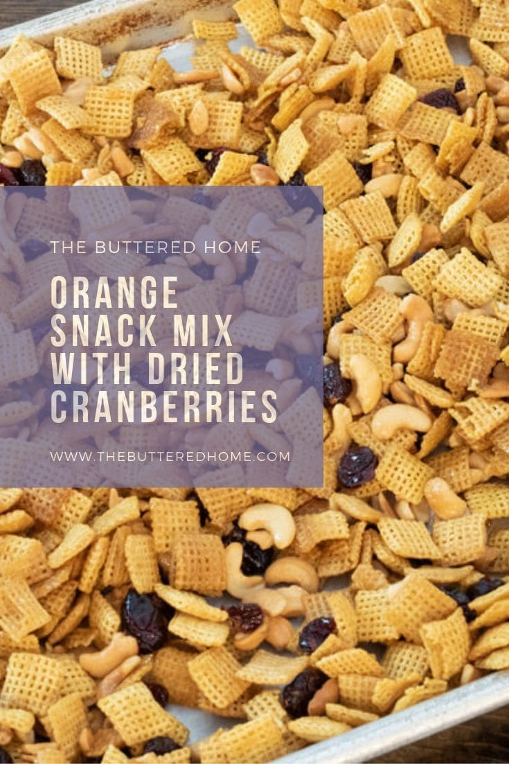Orange snack mix with dried cranberries and nuts is the perfect amount of sweet with a touch of tang. A quick and easy go to snack recipe. You can bag this up and take it with you wherever you are headed! #orangecranberrysnackmix #chexmix #snacks